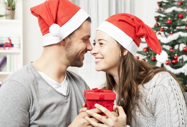 Couple with presents at Christmas