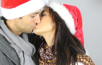 young couple steal a kiss, mistletoe, Christmas
